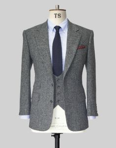 Thom Sweeney Three Piece Suit....maybe with a blue and yellow stripef tie