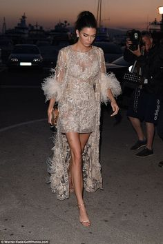 Making an entrance:Kendall, who has been gracing the hottest parties at the festival, knew how to shine in her incredible mini with a matching coat