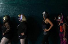 Mexican lucha libre wrestlers wait for a practice session at a gymnasium in Mexico City, September 27, 2011.  REUTERS/Carlos Jasso