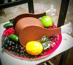 Whoville roast beast prop made from dollar store army helmet, paddle ball paddles, and fake fruit. Bon apetit!