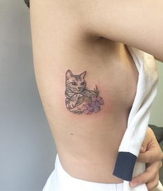 Feminine cat tattoo