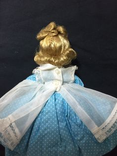 "She has her original pantaloons, white socks and black shoes. Amy has blinking blue-gray eyes, jointed legs with bendable knees and turning head with just a few fly-away hairs. She stands 8"" tall on the stand to topknot in her blonde hair and has ALEX in raised letters on her back. 