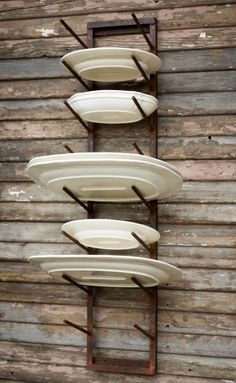 """Rustic Iron Platter Rack-A sturdy industrial-kitchen style way to display your platters and trays. Sturdy, rustic and fabulous farm.house.swag!9"""" x 8.5"""" x 43.5""""Made of iron."""
