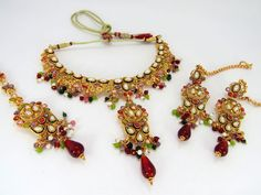 Polki Necklace Set in High Gold Plating and real Polki Stones.  Our products include : ** Kundan Necklace Sets. Indian Imitation Kundan Bridal Sets. Kundan Jewellery ** Ethnic Jewellery, Traditional Gold Plated Jewelry, Polki Jewelry, Polki Bangles and Necklace Sets ** Antique Jewellery in Peacock designs - Copper Necklaces ** Indian Jewellery, Exclusive Design at the Cheapest Rate you can get anywhere.
