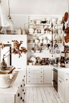 1890's weatherboard cottage in Queensland, Australian, home of photographer and stylist Kara Rosenlund and her husband, is crammed with beautiful treasures in shades of brown and white. | Tiny Homes