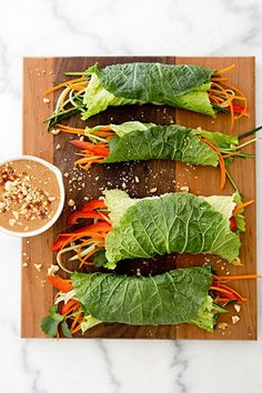 wraps with spicy peanut dipping sauce are perfect for a light lunch. Cabbage wraps with spicy peanut dipping sauce are perfect for a light lunch. Cabbage wraps with spicy peanut dipping sauce are perfect for a light lunch. Raw Food Recipes, Cooking Recipes, Healthy Recipes, Lunch Recipes, Wrap Recipes, Cooking Tips, Easy Recipes, Dinner Recipes, Dessert Recipes