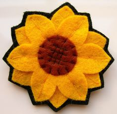 Brighten up any outfit with this felt sunflower pin!    This sunflower has been handstitched from felt, and has a brooch clasp securely stitched on th