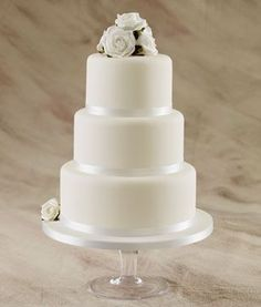 This was our wedding cake but with black ribbon and a D for a topper.
