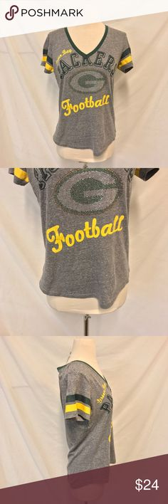 NFL Green Bay Packers Embellished V Neck Tee NFL. Green Bay Packers. Size medium. Gray v Neck Short Sleeve t shirt with green. Embellished logo. Soft and lightweight material. Excellent used condition with no signs of wear. Bust: 18.5 inches. Length: 26.5 inches. ALL MEASUREMENTS ARE TAKEN WITH ITEM LAYING FLAT. 48% polyester, 39% cotton, & 13% rayon. ||894|| NFL Tops Tees - Short Sleeve