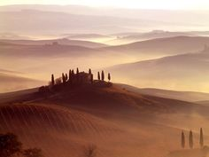 <p>Photo: A house sitting on top of rolling hills</p>