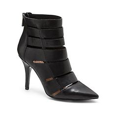 "GEENA-Start a fashion revolution with the Vince Camuto Geena. A very modern take on the requisite gladiator, these unique pointed booties feature slotted cut outs for graphic edge. A moto jacket will play up your tough-girl vibe.  <li> 3.5"" heel"