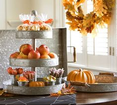 Cute way to repurpose cake pans for an autumn table display!