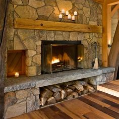 The fireplace, with its raised hearth, takes center stage in the dining room and can be enjoyed from the whole first floor. A small door to the left opens to the outdoors, making it easy to restock the woodpile.