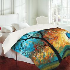 This is an awesome bed spread you can find this at http://denydesigns.com/collections/deny-24-hour-sale/products/madart-inc-aqua-burn-duvet-cover