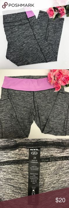 N.Y.L. Workout capris. Size XXL. Grey.  M64 N.Y.L.  Workout capris.  Heathered Grey and light purple.  Size XXL.  New without tags. I just didn't like the fit on my body, I like a higher rise waist. N.Y.L. Pants Capris