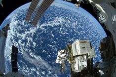 Look at our beautiful world!  NASA astronaut Reid Wiseman works outside the space station's Quest airlock for the Expedition 41 crew aboard the International Space Station in this image released Oct. 8. NASA / Reuters.  74 Of The Most Amazing News Photos Of 2014
