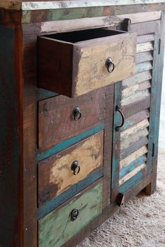 La Rambla Tall Cabinet: Grunge is back and it's willing to act home to your beloved linen. Use it in your bedroom or in the living room. It can also double up as your secret bar. The shutter has a horizontal partition to increase the storage space. The wood used in the product is reclaimed from pieces dating back nearly a 100 years and each component has its own unique texture.