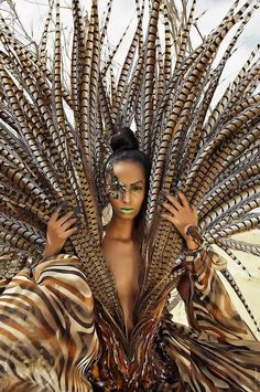 love the feathers.....tribal meets glam fashion