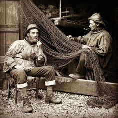 "papat39: "" Irish fisherman repair their nets and enjoy their pipes. """