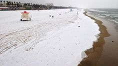 Rare occurrence!  Snow (well, really hail) on Huntington Beach, California, March 1, 2015. http://www.washingtonpost.com/blogs/capital-weather-gang/wp/2015/03/03/hail-hits-huntington-beach-and-californians-promptly-freak-out/