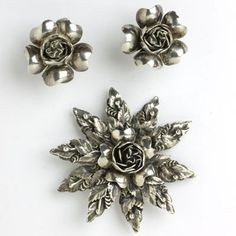 One of Hobe's more unusual designes from the 1940s, this sterling silver brooch and earrings set is incredibly rich in texture and detail.