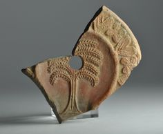 North African red slip oil lamp fragment with plant 1