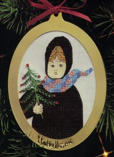 P. Buckley Moss cross-stitch Christmas ornament.