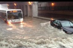 Power outages, submerged cars, flooded subway stations. Photos show parts of Toronto hit by floods after heavy rains Monday, July 8, 2013