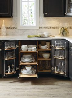The Supercabinet, by Thomasville Cabinetry, features pullout shelves and chrome racks that have enough space to store all of your favorite dishware.