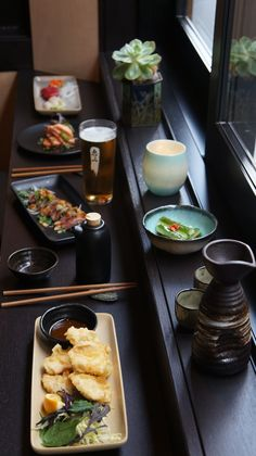 Chicken Tempura, Beef Tataki, Salmon Aburi, Mixed Sashimi, Cucumber and Chilli Salad, Kirin Lager and Daijingyo Sake