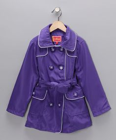 This water-resistant trench features a longer length and two hand pockets to keep girls covered from the weather. Posh points like contrast piping and a vivid hue combine with a double-breasted silhouette and a sash to create a classic with a trendy twist.