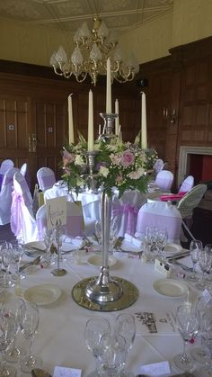 Candelabra in vintage style lilac pinks and creams Dumbleton hall wedding venue