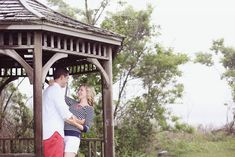 Lovely foggy engagement photo in the rain in a gazebo on the beach.  Great idea for Cape Cod style preppy outfits for an engagement shoot.  Clean, simple, pops of color.  Shot at Odiorne Point State Park in Rye, NH... #Odiornepoint #engagementphotography #dreamlovephotography #gazebo #jcrew