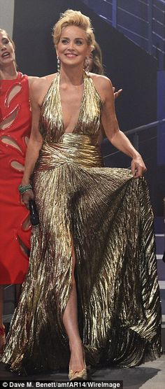 Fabulous at 56! Sharon Stone looked gorgeous in two cleavage-bearing floor-length gowns whilst working the Cannes party circuit in France Th...