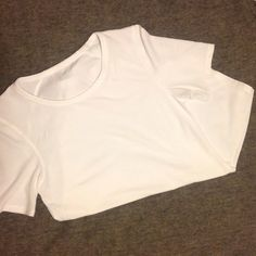 Lululemon Top Worn only once. Great condition. Very comfortable! I do not know the name of the top. If you do know the name of you, you can definitely let me know. The tag was cut off because it was bothering me but it is a size 2 and guaranteed authentic. It has short sleeves and a curved hem. Please do let me know if you would like more pictures! lululemon athletica Tops Tees - Short Sleeve