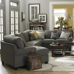 Left Cuddler Sectional.  It would be tight, but my table would fit.  Could add the corner unit & armless loveseat & gain the right amount of leg room.