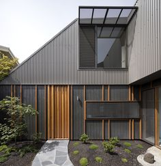 Completed in 2016 in Thornbury, Australia. Images by Tatjana Plitt. The Thornbury House is a low cost, compact family home set within a quiet, inner-suburban context. The design is underpinned by its playful roof form. Timber Battens, Timber Cladding, Exterior Cladding, Cladding Ideas, Exterior Shutters, Grey Exterior, Exterior Colors, Exterior Design, Cafe Exterior