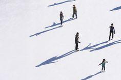 Aerial view of people skating in community rink during winter holiday season - Aerial view of people skating in community rink during winter holiday season