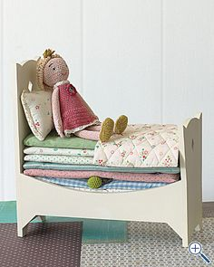 if i could find a little wood doll bed at a thrift/antiques store, this concept isn't out of reach...