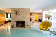 MID CENTURY MODERN - I love the position of the starburst clock!