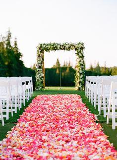 Romantic pink flower petal wedding aisle