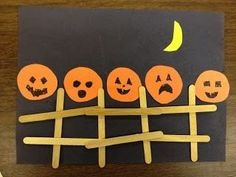 5 little pumpkins on a fence