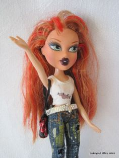 BRATZ Pretty in Punk Meygan. Wearing a Rock Angelz top with the Twins grunge jeans. The handbag is from  Pretty in Punk. The belt hasn't been identified.