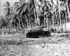 Aug. 29, 1942: After landing in force, U.S. Marines pause on the beach of Guadalcanal in the Solomon Islands before advancing inland against the Japanese during World War II