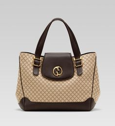'gucci 1973' medium tote with double G detail.
