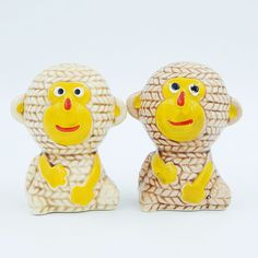 SOLD - Set of vintage pre-owned figural novelty gloss glazed porcelain ceramic salt and pepper shakers set.  The brown monkeys have a textured appearance that looks like coiled rope was used to form the monkeys.  Each monkey has a yellow face with red, black and white accents and yellow hands. #Vintage #Monkey #SaltAndPepperShakers