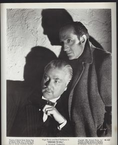 "Original 1946 photo from the Universal Studios Sherlock Holmes film ""Dressed To Kill"" featuring Nigel Bruce and Basil Rathbone."