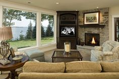 Position the TV for subtlety. The layout of this room is a great solution for those who don't want the TV to dominate the room. The TV's placement lets the fireplace be the focal point.
