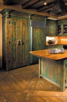 The cabinets for this cabin kitchen were constructed using antique Mexican doors, moulding from an antique hutch, antique carved panels and salvaged lumber. Rustic Cabin Kitchens, Solid Wood Kitchens, Rustic Kitchen Cabinets, Craftsman Kitchen, Antique Hutch, Remodels And Restorations, Craftsman Bungalows, Victorian Architecture, Magnolia Homes