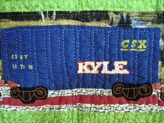 Detail of Rolling Stock Quilt by Faith Agostinone Wilson. CSX boxcar.